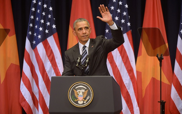US President Barack Obama waves after delivering a speech at the National Convention Center in Hanoi on May 24, 2016. Obama, currently on a visit to Vietnam, met with civil society leaders including some of the country's long-harassed critics on May 24. / AFP / POOL / HOANG DINH NAM (Photo credit should read HOANG DINH NAM/AFP/Getty Images)