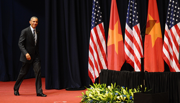 US President Barack Obama smiles as he arrives to give a speech at the National Convention Center in Hanoi on May 24, 2016. Obama, currently on a visit to Vietnam, met with civil society leaders including some of the country's long-harassed critics on May 24. / AFP / POOL / HOANG DINH NAM (Photo credit should read HOANG DINH NAM/AFP/Getty Images)