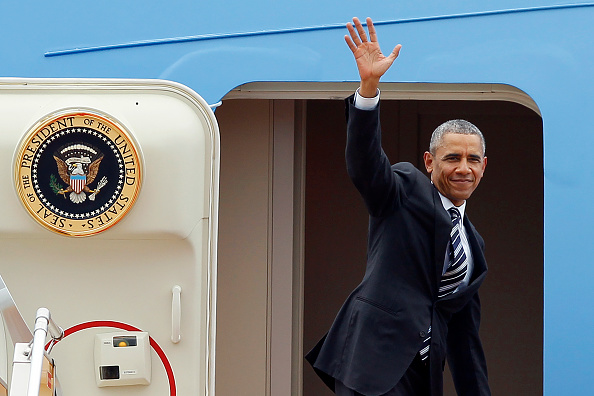 US President Barack Obama waves as he boards Air Force One upon his departure from Noi Bai international airport in Hanoi on May 24, 2016, headed for Ho Chi Minh City in the south. US President Barack Obama told communist Vietnam on May 24 that basic human rights would not jeopardise its stability, in an impassioned appeal for the one-party state to abandon authoritarianism. / AFP / POOL / LUONG THAI LINH (Photo credit should read LUONG THAI LINH/AFP/Getty Images)