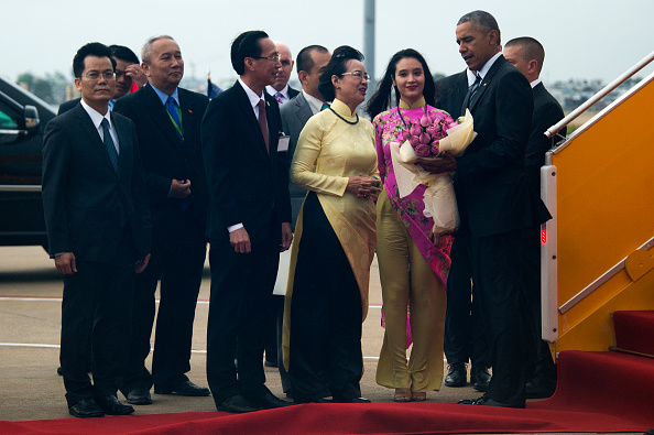 US President Barack Obama (R) is welcomed upon his arrival at Tan Son Nhat Airport in Ho Chi Minh City on May 24, 2016. US President Barack Obama told communist Vietnam on May 24 that basic human rights would not jeopardise its stability, in an impassioned appeal for the one-party state to abandon authoritarianism. / AFP / JIM WATSON (Photo credit should read JIM WATSON/AFP/Getty Images)
