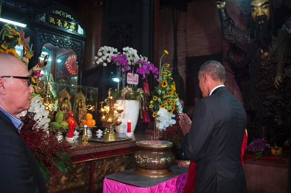 US President Barack Obama (R) gestures during a visit to the Jade Pagoda in Ho Chi Minh City on May 24, 2016. US President Barack Obama told communist Vietnam on May 24 that basic human rights would not jeopardise its stability, in an impassioned appeal for the one-party state to abandon authoritarianism. / AFP / JIM WATSON (Photo credit should read JIM WATSON/AFP/Getty Images)