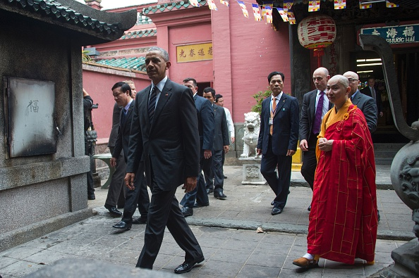 US President Barack Obama (L) walks with Abbot of the Jade Emperor Pagoda Thich Minh Thong (R) during a visit to the Jade Pagoda in Ho Chi Minh City on May 24, 2016. US President Barack Obama told communist Vietnam on May 24 that basic human rights would not jeopardise its stability, in an impassioned appeal for the one-party state to abandon authoritarianism. / AFP / JIM WATSON (Photo credit should read JIM WATSON/AFP/Getty Images)