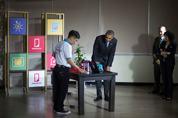 US President Barack Obama (C) looks at an exhibite as he tours through the Entrepreneur Demonstrations at DreamPlex in Ho Chi Minh City on May 24, 2016. US President Barack Obama told communist Vietnam on May 24 that basic human rights would not jeopardise its stability, in an impassioned appeal for the one-party state to abandon authoritarianism. / AFP / JIM WATSON (Photo credit should read JIM WATSON/AFP/Getty Images)