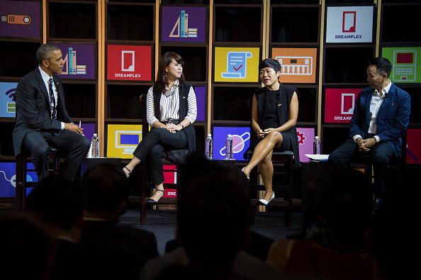US President Barack Obama (L) speaks with entrepreneurs at DreamPlex in Ho Chi Minh City on May 24, 2016. Obama told communist Vietnam on May 24 that basic human rights would not jeopardise its stability, in an impassioned appeal for the one-party state to abandon authoritarianism. / AFP / JIM WATSON (Photo credit should read JIM WATSON/AFP/Getty Images)