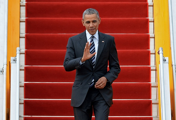 US President Barack Obama waves as he walks down the stairs after he disembarked from Air Force One upon his arrival at the Tan Son Nhat airport in Ho Chi Minh City on May 24, 2016. Obama told communist Vietnam that basic human rights would not jeopardise its stability, in an impassioned appeal for the one-party state to abandon authoritarianism. / AFP / CHRISTOPHE ARCHAMBAULT (Photo credit should read CHRISTOPHE ARCHAMBAULT/AFP/Getty Images)