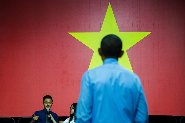 US President Barack Obama is asked a question by a member of the audience as he speaks at the Young Southeast Asian Leaders Initiative town hall event in Ho Chi Minh City on May 25, 2016. Obama urged communist Vietnam on May 24 to abandon authoritarianism, saying basic human rights would not jeopardise its stability, after Hanoi barred several dissidents from meeting the US leader. / AFP / JIM WATSON (Photo credit should read JIM WATSON/AFP/Getty Images)