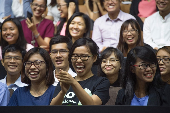 A member of the audience smiles as she asks US President Barack Obama (not pictured) a question as he speaks at the Young Southeast Asian Leaders Initiative town hall event in Ho Chi Minh City on May 25, 2016. Obama urged communist Vietnam on May 24 to abandon authoritarianism, saying basic human rights would not jeopardise its stability, after Hanoi barred several dissidents from meeting the US leader. / AFP / JIM WATSON (Photo credit should read JIM WATSON/AFP/Getty Images)