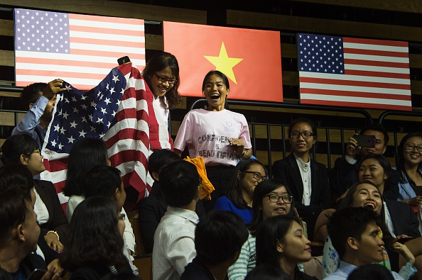 Members of the audience hold up a flag and pose a question to US President Barack Obama as he speaks at the Young Southeast Asian Leaders Initiative town hall event in Ho Chi Minh City on May 25, 2016. Obama urged communist Vietnam on May 24 to abandon authoritarianism, saying basic human rights would not jeopardise its stability, after Hanoi barred several dissidents from meeting the US leader. / AFP / JIM WATSON (Photo credit should read JIM WATSON/AFP/Getty Images)
