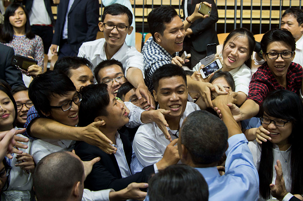 US President Barack Obama (bottom R) shakes hands with members of the audience after speaking at the Young Southeast Asian Leaders Initiative town hall event in Ho Chi Minh City on May 25, 2016. Obama urged communist Vietnam on May 24 to abandon authoritarianism, saying basic human rights would not jeopardise its stability, after Hanoi barred several dissidents from meeting the US leader. / AFP / JIM WATSON (Photo credit should read JIM WATSON/AFP/Getty Images)