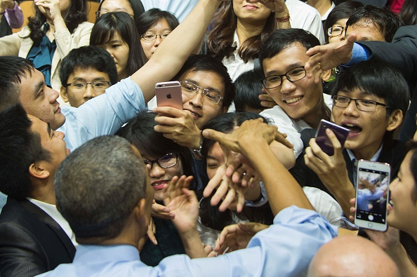 US President Barack Obama (bottom L) shakes hands with members of the audience after speaking at the Young Southeast Asian Leaders Initiative town hall event in Ho Chi Minh City on May 25, 2016. Obama urged communist Vietnam on May 24 to abandon authoritarianism, saying basic human rights would not jeopardise its stability, after Hanoi barred several dissidents from meeting the US leader. / AFP / JIM WATSON (Photo credit should read JIM WATSON/AFP/Getty Images)