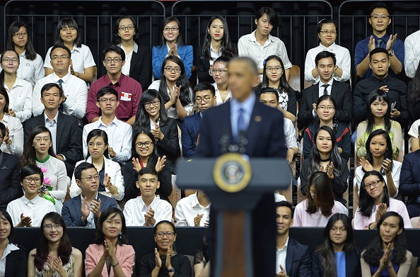 Participants listen as US President Barack Obama (C) speaks at a Young Southeast Asian Leaders Initiative town hall event in Ho Chi Minh City on May 25, 2016. Obama fielded questions on May 25 on everything from rap and weed smoking to leadership and his good looks at a lively town hall-style meeting with young Vietnamese, who say the US leader is a far cry from their staid Communist rulers. / AFP / CHRISTOPHE ARCHAMBAULT (Photo credit should read CHRISTOPHE ARCHAMBAULT/AFP/Getty Images)