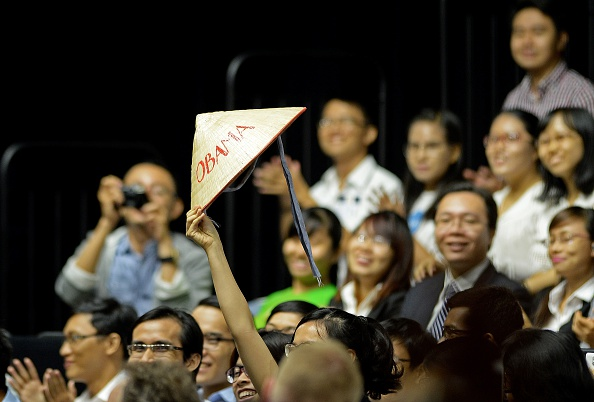 A woman holds up a Vietnamese hat with Obama written on it as US President Barack Obama (not pictured) speaks at a Young Southeast Asian Leaders Initiative town hall event in Ho Chi Minh City on May 25, 2016. Obama fielded questions on May 25 on everything from rap and weed smoking to leadership and his good looks at a lively town hall-style meeting with young Vietnamese, who say the US leader is a far cry from their staid Communist rulers. / AFP / CHRISTOPHE ARCHAMBAULT (Photo credit should read CHRISTOPHE ARCHAMBAULT/AFP/Getty Images)