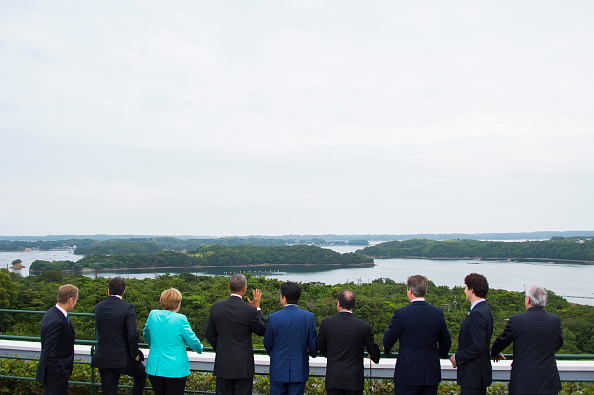 (From L) European Council President Donald Tusk, Italian Prime Minister Matteo Renzi, German Chancellor Angela Merkel, US President Barack Obama, Japanese Prime Minister Shinzo Abe, French President Francois Hollande, British Prime Minister David Cameron, Canadian Prime Minister Justin Trudeau and European Commission President Jean-Claude Juncker look at the view after posing for the family photo during the first day of the Group of Seven (G7) summit meetings in Ise city on May 26, 2016. World leaders kick off two days of G7 talks in Japan on May 26 with the creaky global economy, terrorism, refugees, China's controversial maritime claims, and a possible Brexit headlining their packed agenda. / AFP / AFP POOL / JIM WATSON (Photo credit should read JIM WATSON/AFP/Getty Images)