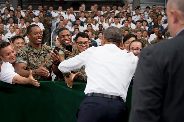 "US President Barack Obama (C) shakes hands with US and Japanese troops during his visit to the Marine Corps Air Station at Iwakuni, near the Japanese city of Hiroshima on May 27, 2016. Obama, who arrived at Iwakuni after attending the G7 Summit in central Japan, hailed the ""great alliance"" between the United States and Japan on May 27, just hours ahead of his historic visit to Hiroshima. / AFP / JIM WATSON (Photo credit should read JIM WATSON/AFP/Getty Images)"