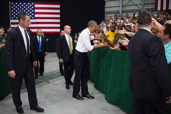 "US President Barack Obama (C) speaks with US troops during his visit to the Marine Corps Air Station at Iwakuni, near the Japanese city of Hiroshima on May 27, 2016. Obama, who arrived at Iwakuni after attending the G7 Summit in central Japan, hailed the ""great alliance"" between the United States and Japan on May 27, just hours ahead of his historic visit to Hiroshima. / AFP / JIM WATSON (Photo credit should read JIM WATSON/AFP/Getty Images)"