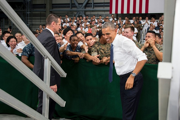 "US President Barack Obama (R) shakes hands with US and Japanese troops during his visit to the Marine Corps Air Station at Iwakuni, near the Japanese city of Hiroshima on May 27, 2016. Obama, who arrived at Iwakuni after attending the G7 Summit in central Japan, hailed the ""great alliance"" between the United States and Japan on May 27, just hours ahead of his historic visit to Hiroshima. / AFP / JIM WATSON (Photo credit should read JIM WATSON/AFP/Getty Images)"