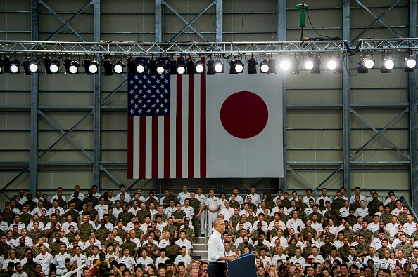 "US President Barack Obama speaks with Us and Japanese troops at Marine Corps Air Station Iwakuni on May 27, 2016. Obama, who arrived at Iwakuni after attending the G7 Summit in central Japan, hailed the ""great alliance"" between the United States and Japan on May 27, just hours ahead of his historic visit to Hiroshima. / AFP / JIM WATSON (Photo credit should read JIM WATSON/AFP/Getty Images)"