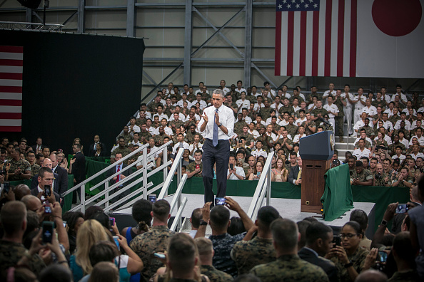 IWAKUNI, JAPAN - MAY 27: U.S. President Barack Obama greets cheering crowd at the Marine Corps Air Station Iwakuni (MCAS Iwakuni) on May 27, 2016 in Iwakuni, Japan. President Barack Obama flew in to the MCAS Iwakuni on Air Force One, and visited the troops before visiting Hiroshima. (Photo by Jean Chung/Getty Images)