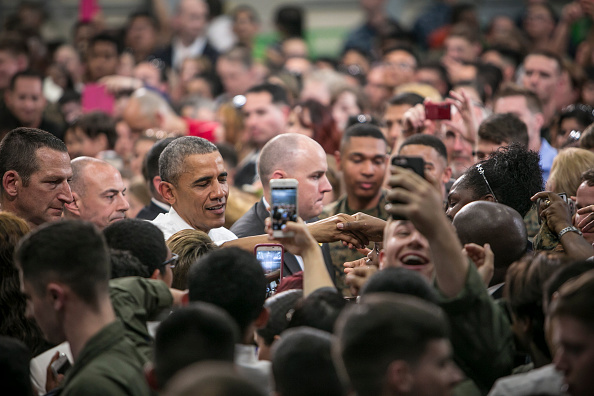 IWAKUNI, JAPAN - MAY 27: U.S. President Barack Obama greets the cheering crowd of the U.S. and Japanese servicemen and their families at the Marine Corps Air Station Iwakuni (MCAS Iwakuni) on May 27, 2016 in Iwakuni, Japan. President Barack Obama flew in to the MCAS Iwakuni on Air Force One, and visited the troops before visiting Hiroshima. (Photo by Jean Chung/Getty Images)
