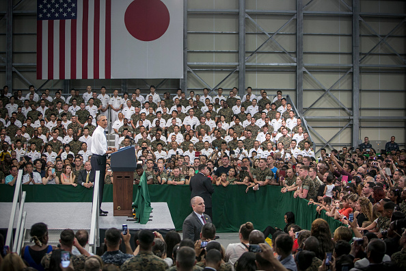IWAKUNI, JAPAN - MAY 27: U.S. President Barack Obama (L) gives a speech to the U.S. and Japanese servicemen and their families at the Marine Corps Air Station Iwakuni (MCAS Iwakuni) on May 27, 2016 in Iwakuni, Japan. President Obama flew in to the MCAS Iwakuni on Air Force One, and visited the troops before visiting Hiroshima. (Photo by Jean Chung/Getty Images)