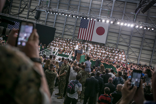 IWAKUNI, JAPAN - MAY 27: U.S. servicemen (L) and (R) take snapshots of the U.S. President Barack Obama (C) during his speech at the Marine Corps Air Station Iwakuni (MCAS Iwakuni) on May 27, 2016 in Iwakuni, Japan. President Obama flew in to the MCAS Iwakuni on Air Force One, and visited the troops before visiting Hiroshima. (Photo by Jean Chung/Getty Images)