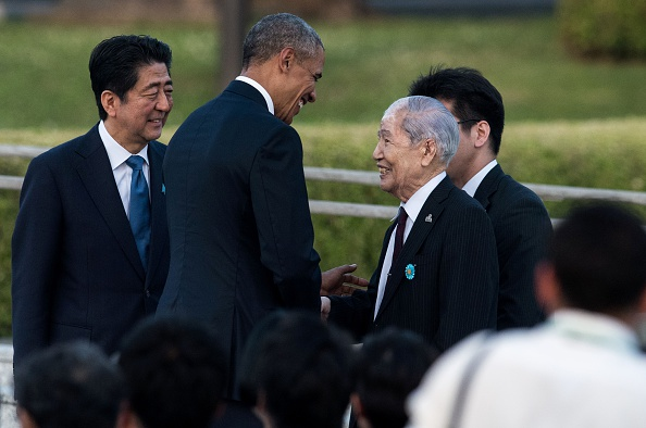 US President Barack Obama (2nd L) shakes hands with Sunao Tsuboi, a survivor of the atomic bombing of Hiroshima, as Japanese Prime Minister Shinzo Abe (L) looks on at the Hiroshima Peace Memorial park cenotaph in Hiroshima on May 27, 2016. Obama became the first sitting US leader to visit the site that ushered in the age of nuclear conflict. / AFP / JOHANNES EISELE (Photo credit should read JOHANNES EISELE/AFP/Getty Images)