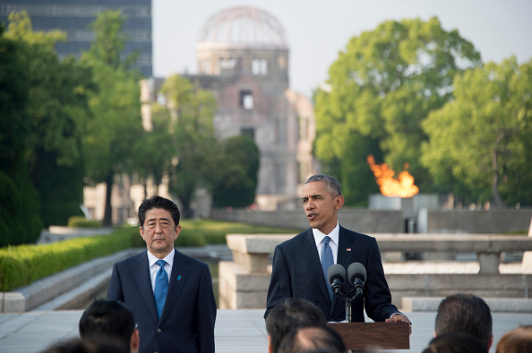 US President Barack Obama delivers remarks after laying a wreath at the Hiroshima Peace Memorial Park as Japan's Prime Minister Shinzo Abe (L) looks on, in Hiroshima on May 27, 2016. Obama on May 27 paid moving tribute to victims of the world's first nuclear attack. / AFP / JIM WATSON (Photo credit should read JIM WATSON/AFP/Getty Images)