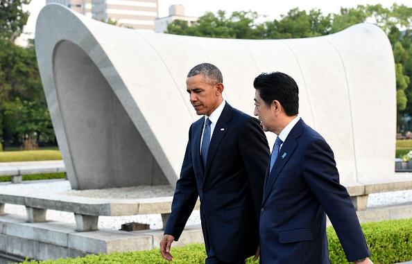 US President Barack Obama (L) and Japanese Prime Minister Shinzo Abe (R) walk beside the cenotaph in the Peace Momorial park in Hiroshima on May 27, 2016. Obama on May 27 paid a moving tribute to victims of the world's first nuclear attack. / AFP / TOSHIFUMI KITAMURA (Photo credit should read TOSHIFUMI KITAMURA/AFP/Getty Images)
