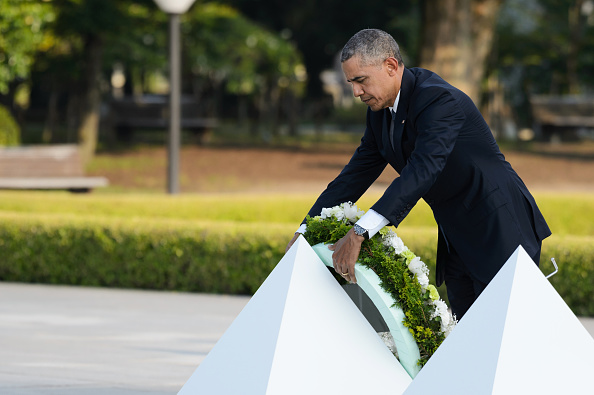 U.S. President Barack Obama places a wreath in front of the cenotaph at the Hiroshima Peace Memorial Park in Hiroshima, Japan, on Friday, May 27, 2016. Nearly 71 years after U.S. forces dropped a devastating nuclear bomb on Hiroshima, Obama became the first American leader to set foot on the soil where so many people died. Photographer: Akio Kon/Bloomberg via Getty Images *** Local Captions *** Barack Obama