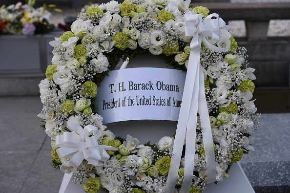 The wreath placed by US President Barack Obama is displayed in front of the cenotoph in the Peace Momorial park in Hiroshima on May 27, 2016. Obama became the first sitting US leader to visit the site that ushered in the age of nuclear conflict. / AFP / TOSHIFUMI KITAMURA (Photo credit should read TOSHIFUMI KITAMURA/AFP/Getty Images)