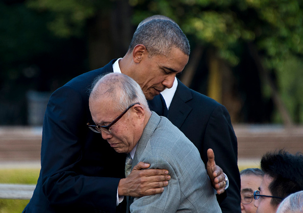 US President Barack Obama hugs Shigeaki Mori (front), a survivor of the 1945 atomic bombing of Hiroshima, during a visit to the Hiroshima Peace Memorial Park on May 27, 2016. Obama on May 27 paid moving tribute to victims of the world's first nuclear attack. / AFP / JIM WATSON (Photo credit should read JIM WATSON/AFP/Getty Images)