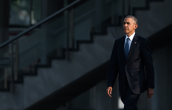 US President Barack Obama arrives at the Hiroshima Peace Memorial park cenotaph in Hiroshima on May 27, 2016. Obama became the first sitting US leader to visit the site that ushered in the age of nuclear conflict. / AFP / JOHANNES EISELE (Photo credit should read JOHANNES EISELE/AFP/Getty Images)