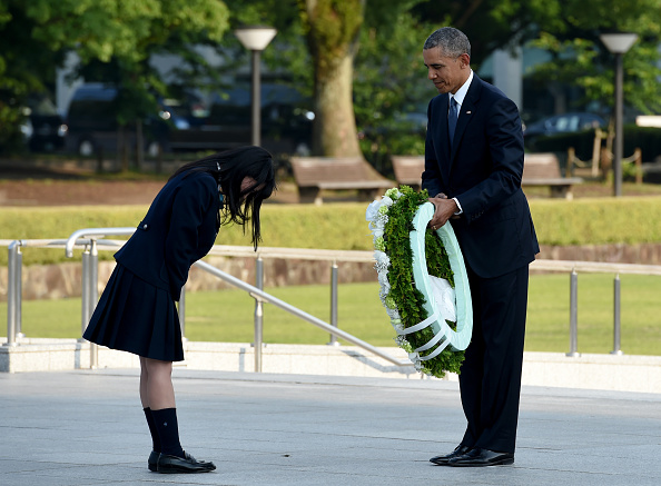 US President Barack Obama (R) recieves a bow from a student (L) at the cenotaph in the Peace Momorial park in Hiroshima on May 27, 2016. Obama became the first sitting US leader to visit the site that ushered in the age of nuclear conflict. / AFP / TOSHIFUMI KITAMURA (Photo credit should read TOSHIFUMI KITAMURA/AFP/Getty Images)