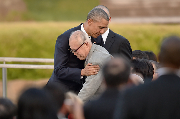 HIROSHIMA, JAPAN - MAY 27: U.S. President Barack Obama embraces atomic bomb survivor Shigeaki Mori during his visit to the Hiroshima Peace Memorial Park on May 27, 2016 in Hiroshima, Japan. It is the first time U.S. President makes an official visit to Hiroshima, the site where the atomic bomb was dropped in the end of World War II on August 6, 1945. (Photo by Atsushi Tomura/Getty Images)