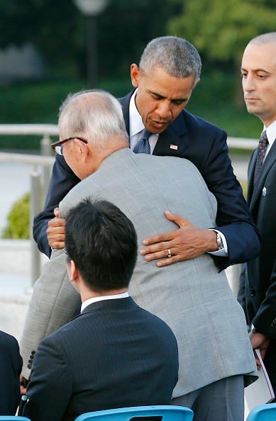 US President Barack Obama (C) hugs Shigeaki Mori, a survivor of the 1945 atomic bombing of Hiroshima, during a visit to the Hiroshima Peace Memorial Park on May 27, 2016. Obama on May 27 paid moving tribute to victims of the world's first nuclear attack. / AFP / POOL / KIMIMASA MAYAMA (Photo credit should read KIMIMASA MAYAMA/AFP/Getty Images)