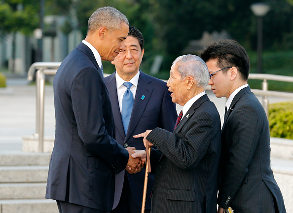 US President Barack Obama (L) speaks with 91-year-old Sunao Tsuboi (2nd R), a survivor of the 1945 atomic bombing of Hiroshima, as Japanese Prime Minister Shinzo Abe (2nd L) listens during a visit to the Hiroshima Peace Memorial Park on May 27, 2016. Obama on May 27 paid moving tribute to victims of the world's first nuclear attack. / AFP / POOL / KIMIMASA MAYAMA (Photo credit should read KIMIMASA MAYAMA/AFP/Getty Images)