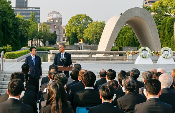 US President Barack Obama (2nd L) delivers his speech next to Japanese Prime Minister Shinzo Abe (L) after laying wreaths in front of a cenotaph to offer a prayer for victims of the atomic bombing in 1945, at Hiroshima Peace Memorial Park in Hiroshima on May 27, 2016. Obama on May 27 paid moving tribute to victims of the world's first nuclear attack. / AFP / POOL / KIMIMASA MAYAMA (Photo credit should read KIMIMASA MAYAMA/AFP/Getty Images)
