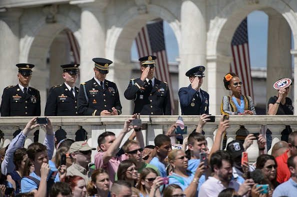 People watch as US President Barack Obama places a wreath at the Tomb of the Unknowns to honor Memorial Day at Arlington National Cemetery May 30, 2016 in Arlington, Virginia. / AFP / Brendan Smialowski (Photo credit should read BRENDAN SMIALOWSKI/AFP/Getty Images)