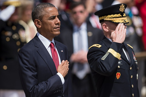 US President Barack Obama (L) and US Major General Bradley A. Becker, Commander of the Military District of Washington, listen to the US national anthem before placing a wreath at the Tomb of the Unknowns to honor Memorial Day at Arlington National CemeteryMay 30, 2016 in Arlington, Virginia. / AFP / Brendan Smialowski (Photo credit should read BRENDAN SMIALOWSKI/AFP/Getty Images)