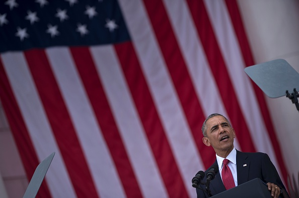 US President Barack Obama speaks during a event to honor Memorial Day at Arlington National Cemetery on May 30, 2016 in Arlington, Virginia. / AFP / Brendan Smialowski (Photo credit should read BRENDAN SMIALOWSKI/AFP/Getty Images)