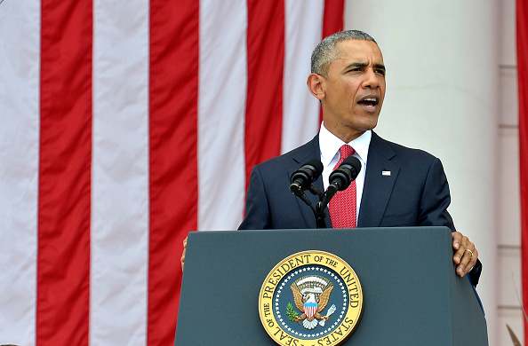 ARLINGTON, VA - MAY 30: (AFP-OUT) President Barack Obama delivers remarks at the Amphitheater after laying a wreath at the Tomb of the Unknown Soldier at Arlington National Cemetery on May 30, 2016 in Arlington, Virginia. Obama paid tribute to the nation's fallen military service members. (Photo by Mike Theiler-Pool/Getty Images)