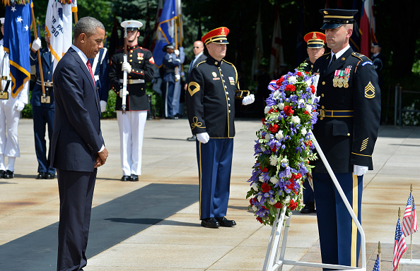 ARLINGTON, VA - MAY 30: (AFP-OUT) President Barack Obama bows his head in silence after laying a wreath at the Tomb of the Unknown Soldier at Arlington National Cemetery on May 30, 2016 in Arlington, Virginia. Obama paid tribute to the nation's fallen military service members. (Photo by Mike Theiler-Pool/Getty Images)