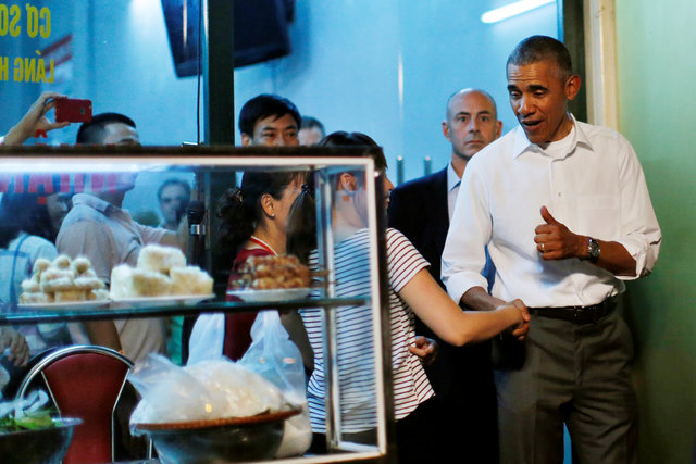 U.S. President Barack Obama shakes hands with a local resident as he leaves after having a dinner with Anthony Bourdain at the restaurant in Hanoi, Vietnam May 23, 2016. REUTERS/Carlos Barria TPX IMAGES OF THE DAY