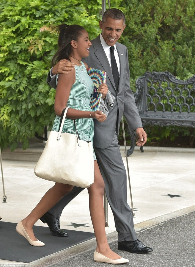 2AA2CF3E00000578-3166498-President_Obama_walks_with_his_daughter_Sasha_14_on_their_way_to-a-93_1437239509609