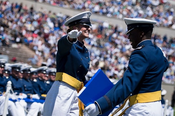 Cadets celebrate during a graduation ceremony at the US Air Force Academy's Falcon Stadium June 2, 2016 in Colorado Springs, Colorado. US President Barack Obama gave the commencement speech at the academy. / AFP / Brendan Smialowski (Photo credit should read BRENDAN SMIALOWSKI/AFP/Getty Images)