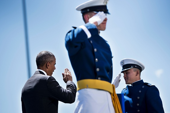 US President Barack Obama congratulates cadets during a graduation ceremony at the US Air Force Academy's Falcon Stadium June 2, 2016 in Colorado Springs, Colorado. / AFP / Brendan Smialowski (Photo credit should read BRENDAN SMIALOWSKI/AFP/Getty Images)