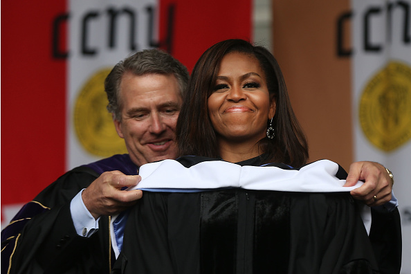 NEW YORK, NY - JUNE 03: First lady Michelle Obama is presented with an honorary doctorate of humane letters by James Milliken, the chancellor for the City University of New York , while delivering the commencement speech at City College on June 3, 2016 in New York City. This is the final commencement speech of her tenure as first lady. In her speech Mrs. Obama celebrated City College's diverse student body and the struggles that many students endured on the road to graduation. (Photo by Spencer Platt/Getty Images)