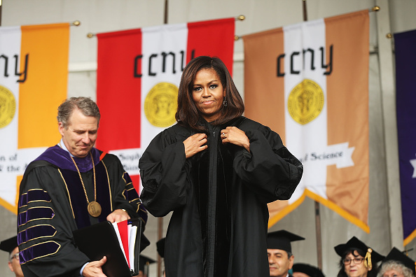 NEW YORK, NY - JUNE 03: First lady Michelle Obama is presented with an honorary doctorate of humane letters by James Milliken, the chancellor for the City University of New York , while delivering the commencement speech at City College on June 3, 2016 in New York City. This is the final commencement speech of her tenure as first lady. In her speech Mrs. Obama celebrated City CollegeÕs diverse student body and the struggles that many students endured on the road to graduation. (Photo by Spencer Platt/Getty Images)