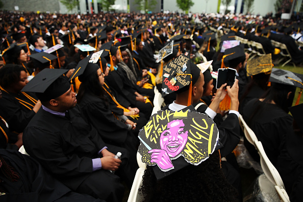 NEW YORK, NY - JUNE 03: Graduating students participate in commencement exercises at City College where First lady Michelle Obama delivered the commencement speech after being presented with an honorary doctorate of humane letters at City College on June 3, 2016 in New York City. This is the final commencement speech of her tenure as first lady. In her speech Mrs. Obama celebrated City CollegeÕs diverse student body and the struggles that many students endured on the road to graduation. (Photo by Spencer Platt/Getty Images)