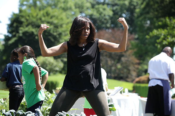 WASHINGTON, DC - JUNE 06: U.S. first lady Michelle Obama gestures during a White House Kitchen Garden harvest June 6, 2016 at the White House in Washington, DC. The first lady welcomed back students from the kitchen garden planting earlier in spring to help the harvest today. (Photo by Alex Wong/Getty Images)